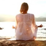 stock-footage-female-meditating-on-the-beach